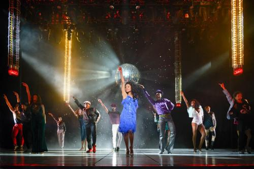 """Ariana DeBose (center) as """"Disco Donna"""" with the cast of La Jolla Playhouse's world premiere of SUMMER: THE DONNA SUMMER MUSICAL; photo by Kevin Berne."""